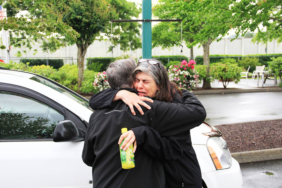 Natalie White embraces Johnny Forrest. White's son Andrew Futerko was killed when his motorcycle collided with Forrest's SUV late in the evening of June 20, 2018. White always had questions about the accident and wanted to meet with Forrest to talk about what happened that night. (Photo: Malin Jordan)