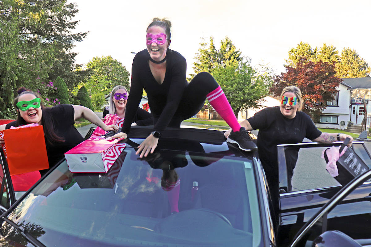 Lower Mainland Wine Ninja group creator Christina Kellie (right) and (sisters and close friends) Sara McArdle, Kelsey Waite, and Jennifer Noble, held a drive-through fundraising event June 20 at the Cloverdale Community Kitchen. (Sarah Grochowski photo)