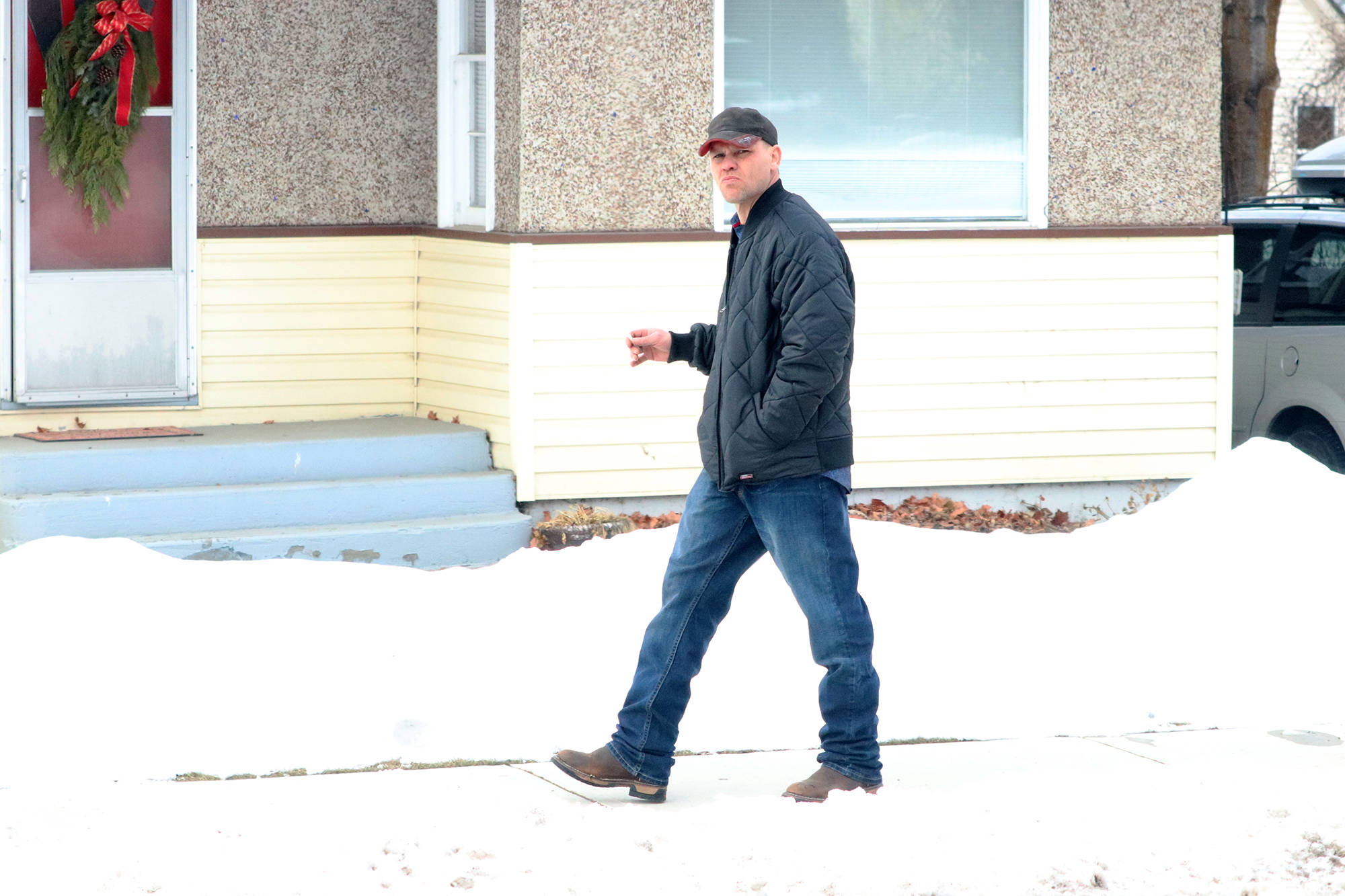 Curtis Sagmoen takes a smoke break during the start of trial Monday, Feb. 10. (Jennifer Smith - Morning Star)