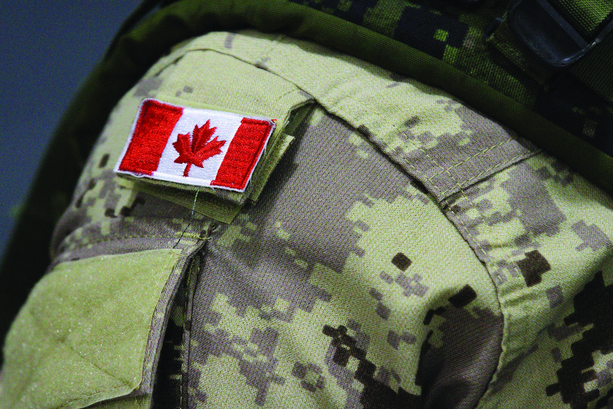 A Canadian flag is shown on the uniform of a member of the military in Trenton, Ont., on Thursday, Oct. 16, 2014. (Photo: THE CANADIAN PRESS/Lars Hagberg)
