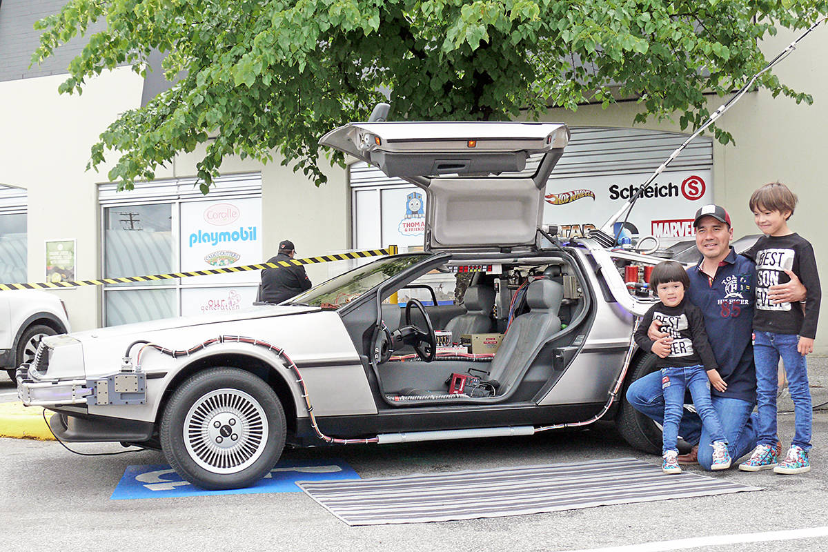 For Father's Day, Sunday, June 21, 2020, Felipe Baird and sons Christian (left) and Adrian (right) had their photo taken with a duplicate of the iconic DeLorean time travelling car from the Back To the Future movies outside the Toy Traders store on the Langley Bypass (Dan Ferguson/Langley Advance Times)
