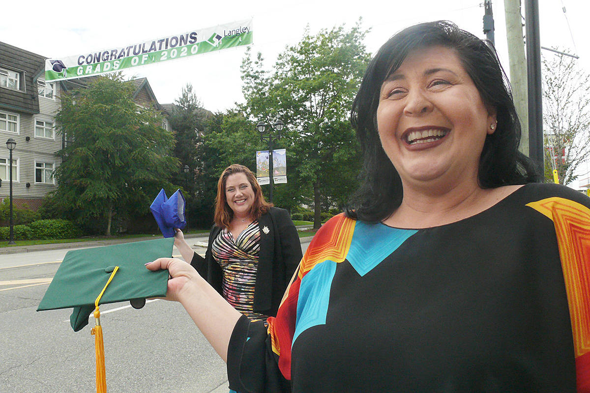 Langley School Board chair Megan Dykeman (right) and Langley City Mayor Val van den Broek were celebrating 2020 grads on Fraser Highway Near 208 Street on Monday, June 22, 2020 (Dan Ferguson/Langley Advance Times)