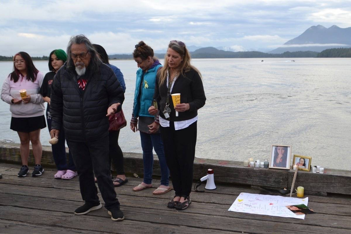 Tla-o-qui-aht elder Levi Martin says a prayer for the RCMP at the vigil for Chantel Moore in Tofino on June 18. Martin said he hopes the relationship that Indigenous people have with the RCMP can change. (Nora O'Malley photo)