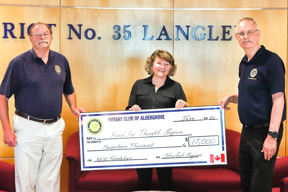 Aldergrove Rotarians and retired school principals George Bryce (left) and Charlie Fox (left) presented a $17,000 cheque to executive director of Langley School District foundation, Susan Cairns, at the district offices on Tuesday, June 18. (Langley School District photo)