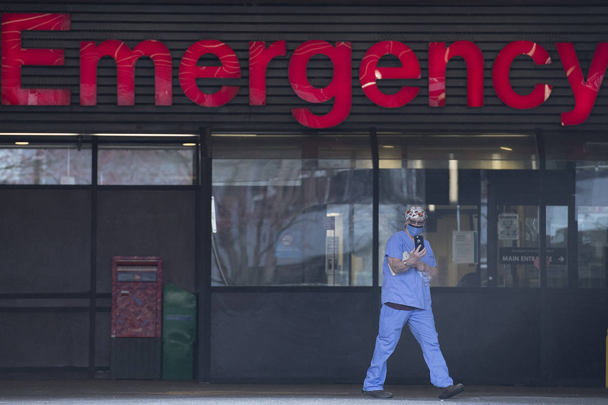 FILE – A health care worker is seen outside the Emergency dept. of the Vancouver General Hospital in Vancouver Monday, March 30, 2020. THE CANADIAN PRESS/Jonathan Hayward