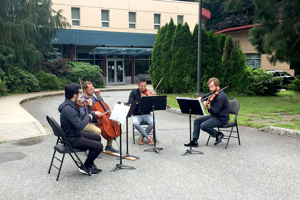 Rose Gellert String Quartet perform in front of Langley Community Music School. (Tawnya Wood/Special to the Langley Advance Times)
