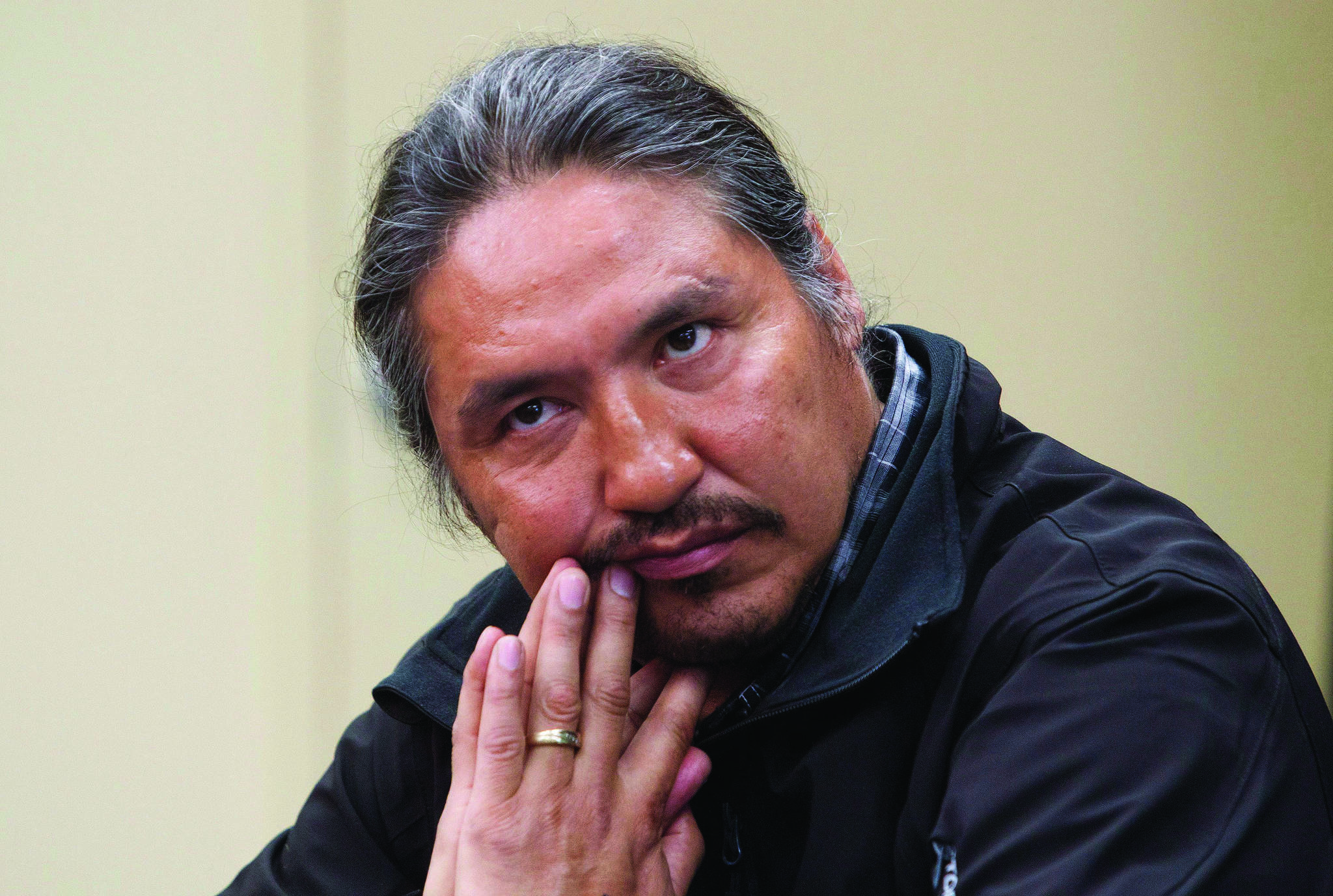 Chief Allan Adam of the Athabasca Chipewyan First Nation listens as Archbishop Desmond Tutu speaks during a press conference in Fort McMurray, Alta. on Friday May 30, 2014. THE CANADIAN PRESS/Jason Franson