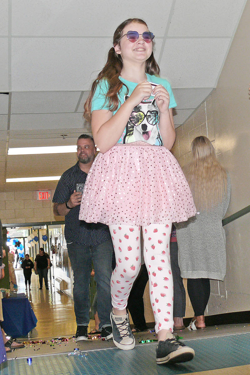 Macey Farrell arrived in high style for her final stroll through Parkside Centennial School in Aldergrove. Students and parents took part in a modified version of the Grade 5 grad walk through the school on June 24, 2020. (Dan Ferguson/Langley Advance Times)