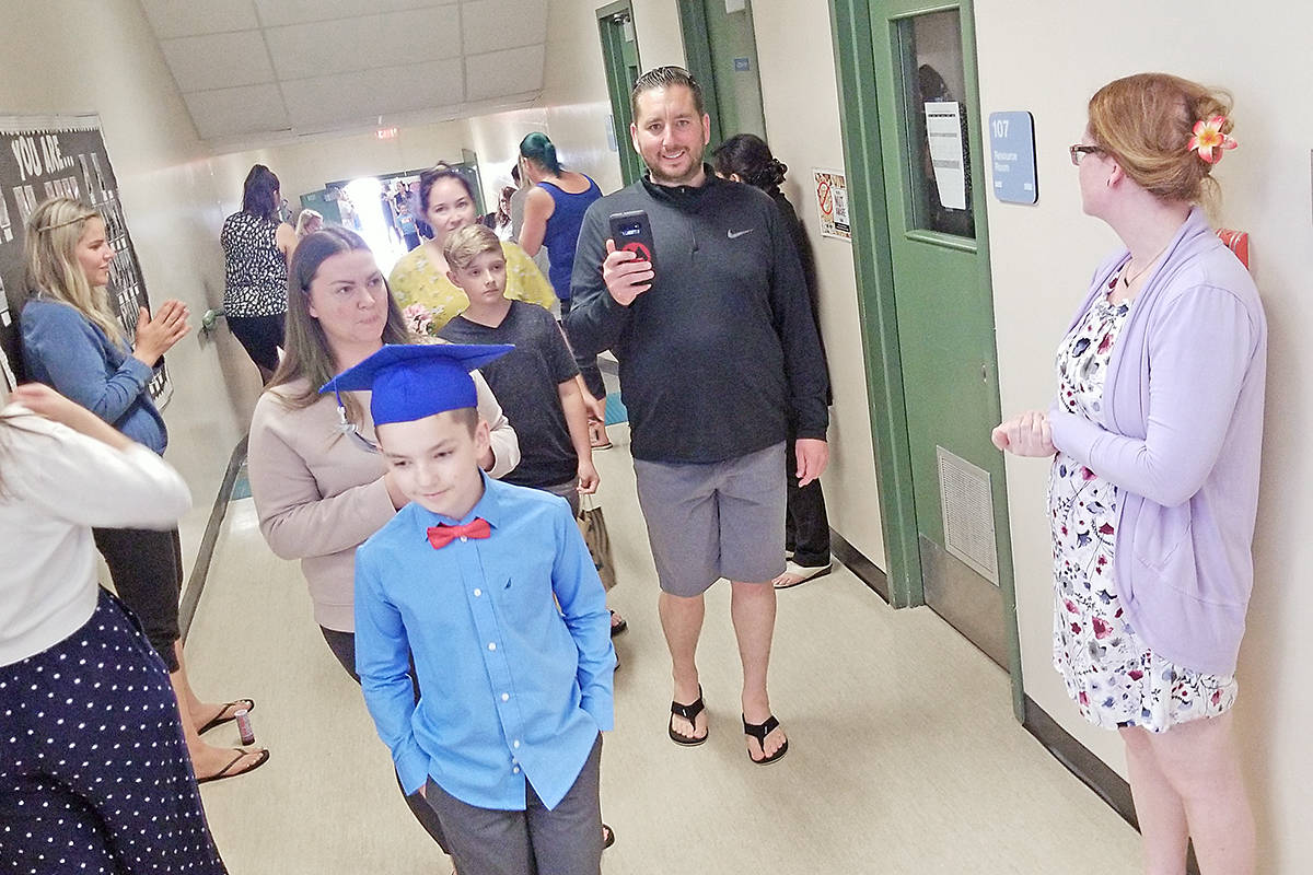 Students and parents took part in a modified version of the Grade 5 grad walk through Parkside Centennial School in Aldergrove on June 24, 2020. (Dan Ferguson/Langley Advance Times)