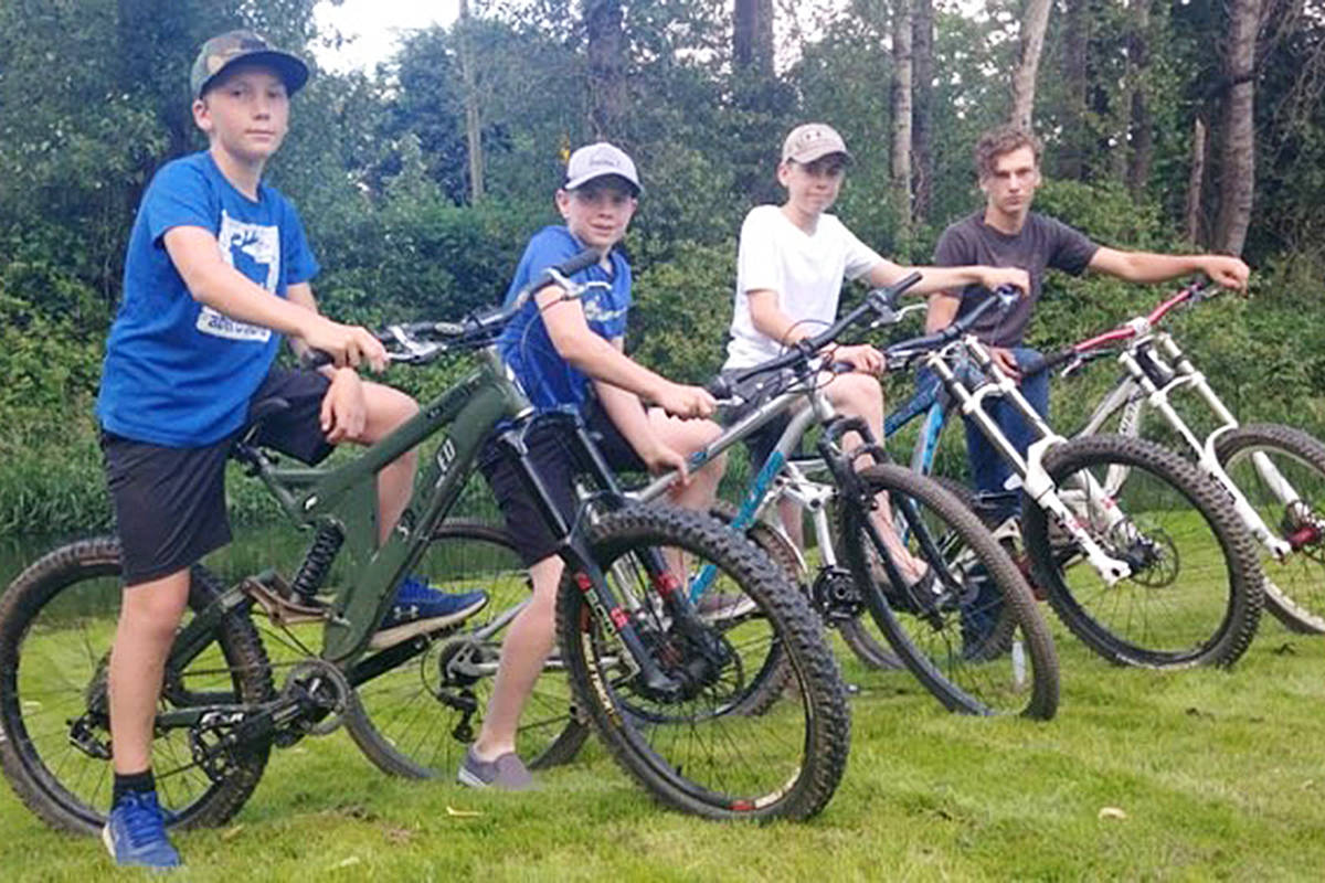 Xander Renaerts, Luke Hampson, Seth Hampson, and Teagan Renaerts, with their downhill bikes. The four were recognized for 'heroic' action after helping an injured man in the Chilliwack Community Forest. (Stephanie Hampson photo)