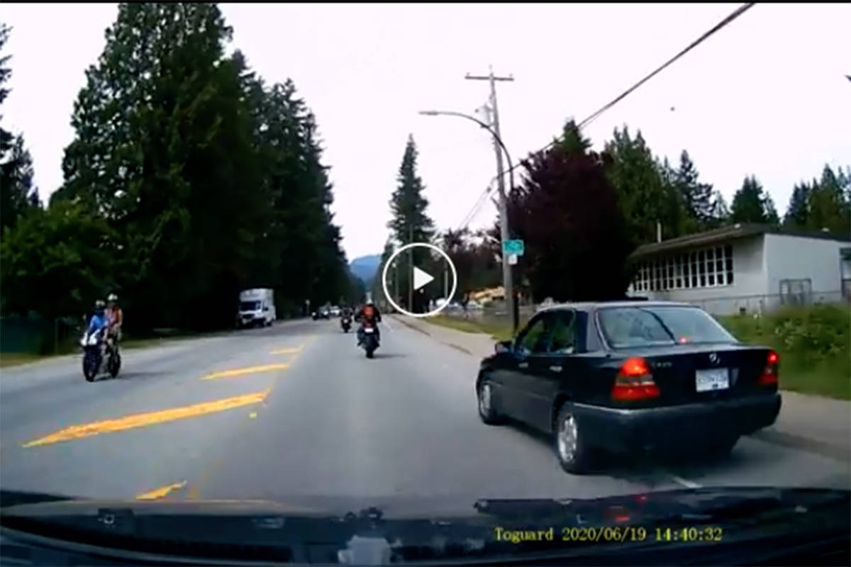 Dashcam footage posted on Reddit June 23, 2020 shows a driver of a car speeding through a Maple Ridge school zone and veering into oncoming traffic passing a pair of motorcycles. (Screenshot)