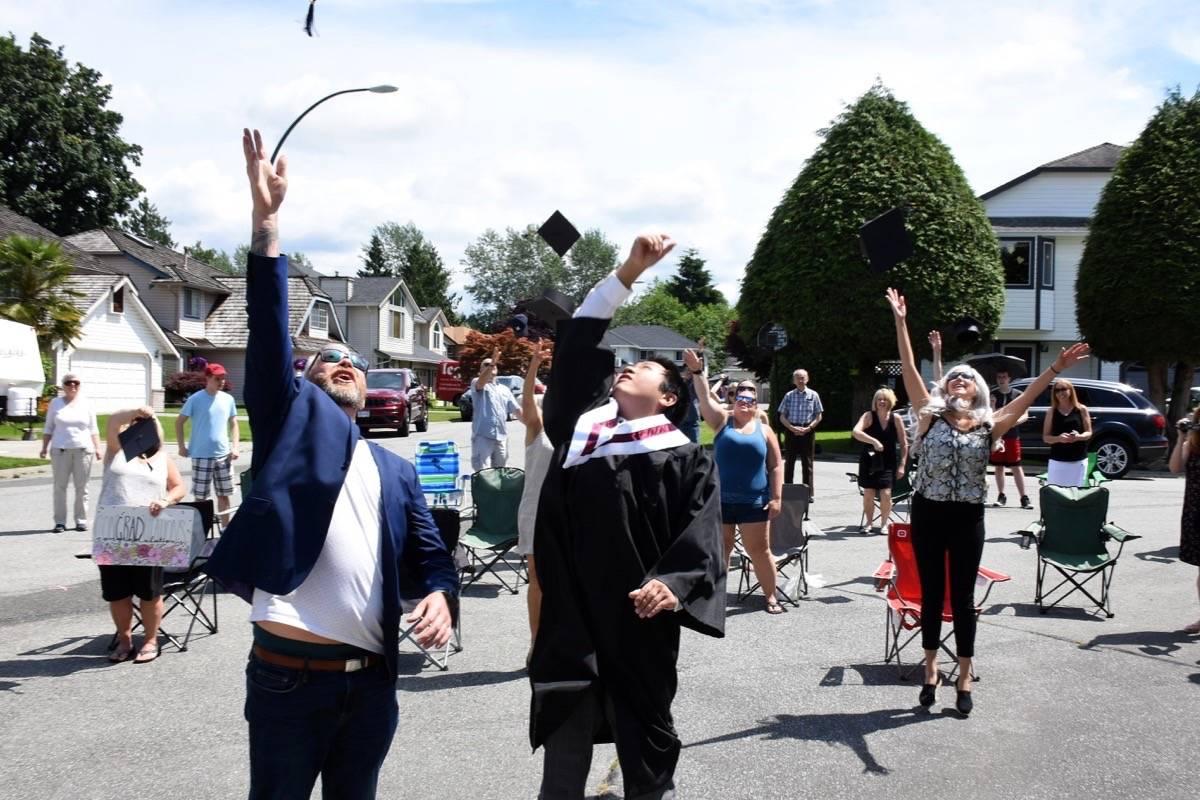 Masato Wong throws his cap into the air. (Colleen Flanagan-THE NEWS)