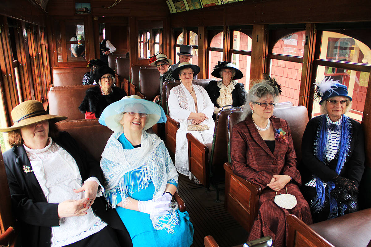 """Members of the Heritage Rail Players sit in the """"Connaught"""" rail car at the Fraser Valley Heritage Railway in Cloverdale. (Photo: Malin Jordan)"""