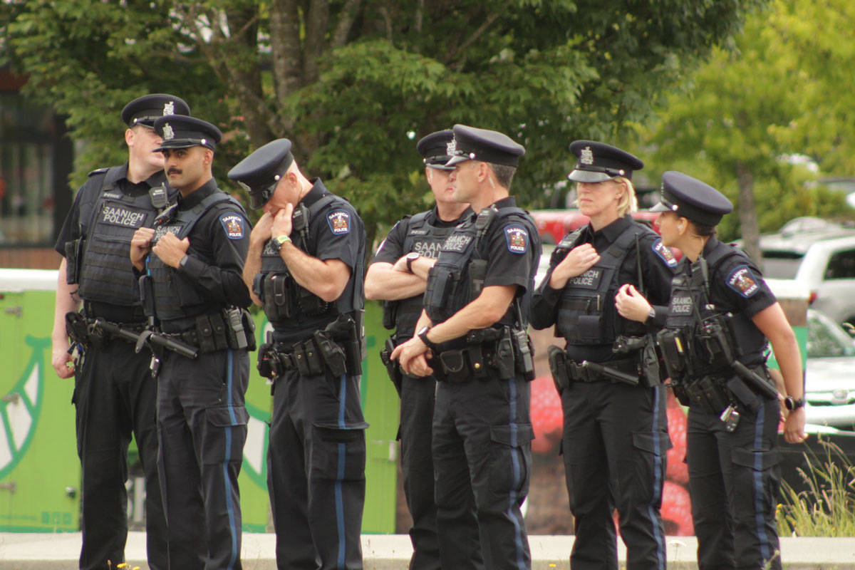 Members of the Greater Victoria police departments joined civilians on Royal Oak Drive on June 27 to pay respects to Capt. Kevin Hagen who was killed in a helicopter crash off the coast of Greece in April. (Devon Bidal/News Staff)