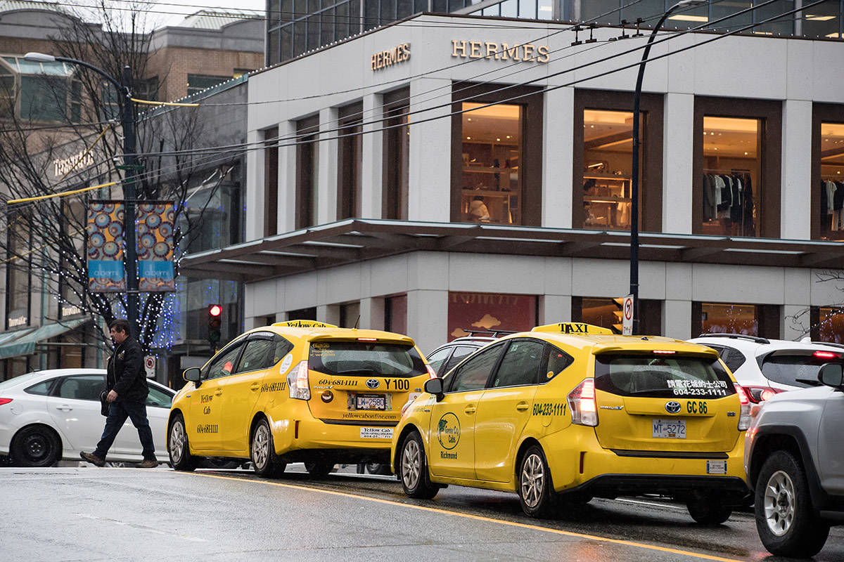 FILE – Taxi drivers wait in traffic in downtown Vancouver, on Thursday January 23, 2020. THE CANADIAN PRESS/Darryl Dyck