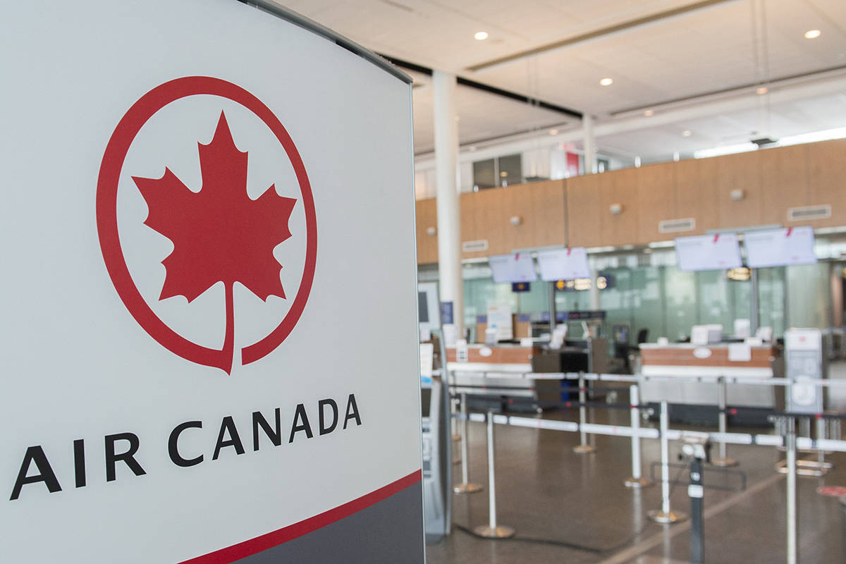 In this May 16, 2020 file photo, an Air Canada check-in area is shown at Montreal-Pierre Elliott Trudeau International Airport. Air Canada says it was bolstering its summer schedule, which nonetheless remains more than 50 per cent smaller than last year as the COVID-19 pandemic continues to pound the airline industry. (File photo by THE CANADIAN PRESS)