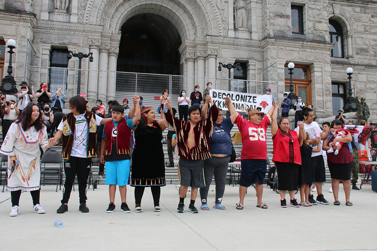 Joseph Thomas, wearing the red jersey with the number 58 on it, gets ready to take a bow with a group of traditional dancers called Joseph's Singers and Dancers after a performance on the Legislature steps. (Kendra Crighton/News Staff)
