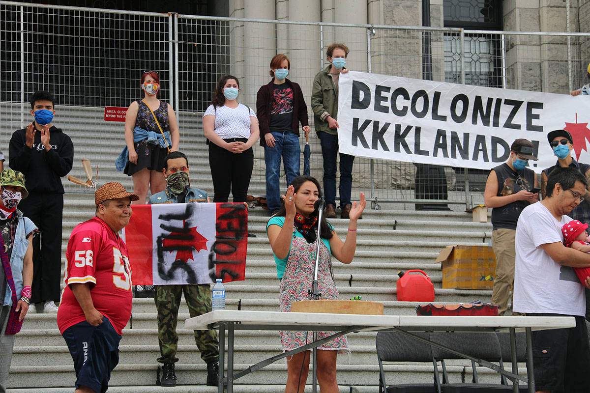 Kati George-Jim, one of the organizers, speaks to the crowd and thanks them for being there. (Kendra Crighton/News Staff)