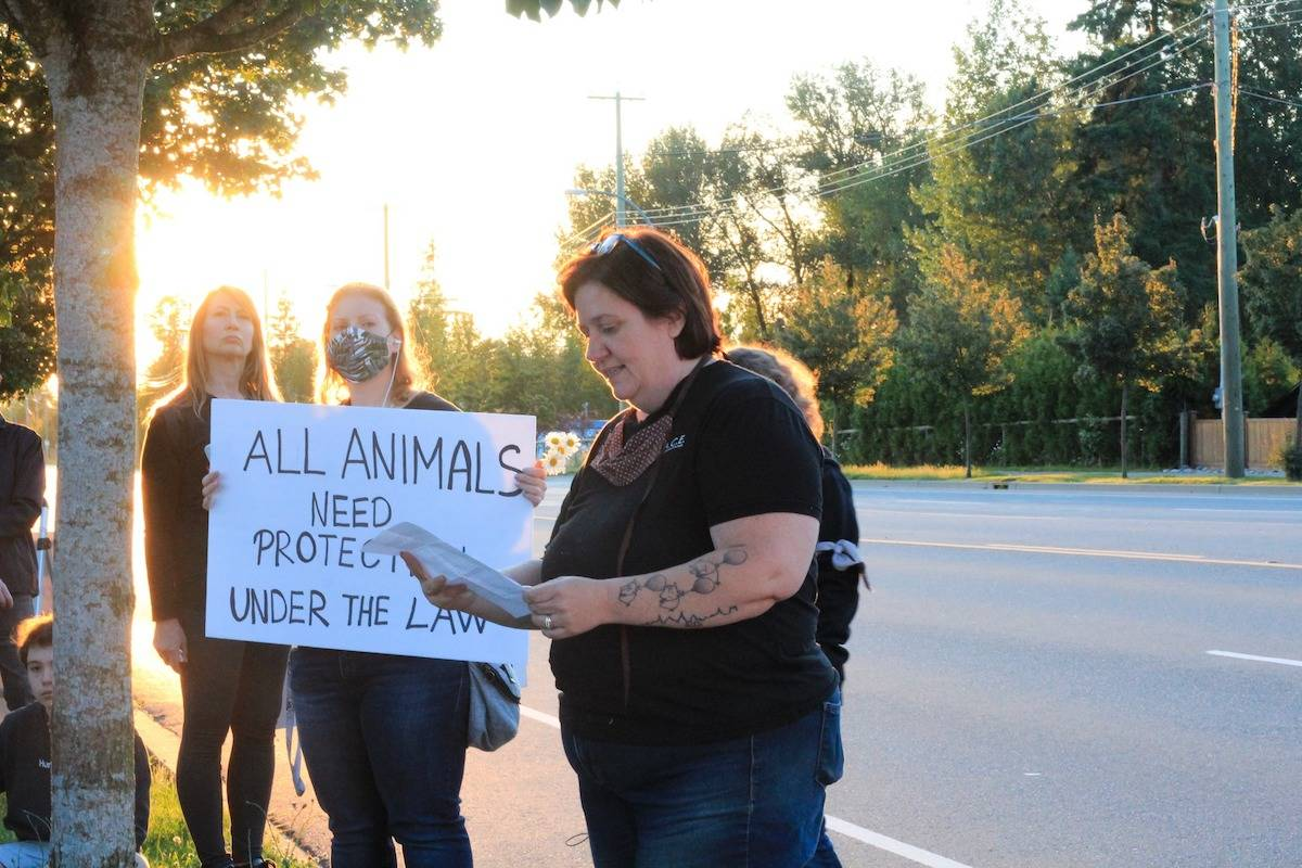 Carrie Shogan, founder of Aldergrove's Little Oink Bank Pig Sanctuary, spoke to a group of demonstrators at a vigil held for activist Regan Russell. (Langley Pig Save/Special to the Star)