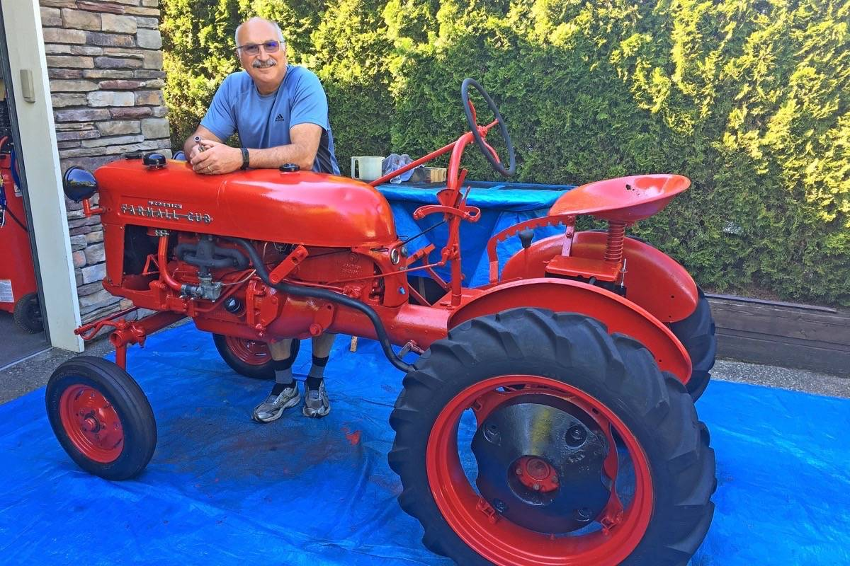 Ron Henze with the 1956 Farmall Cub he restored for his best friend's father. (Contributed photo)