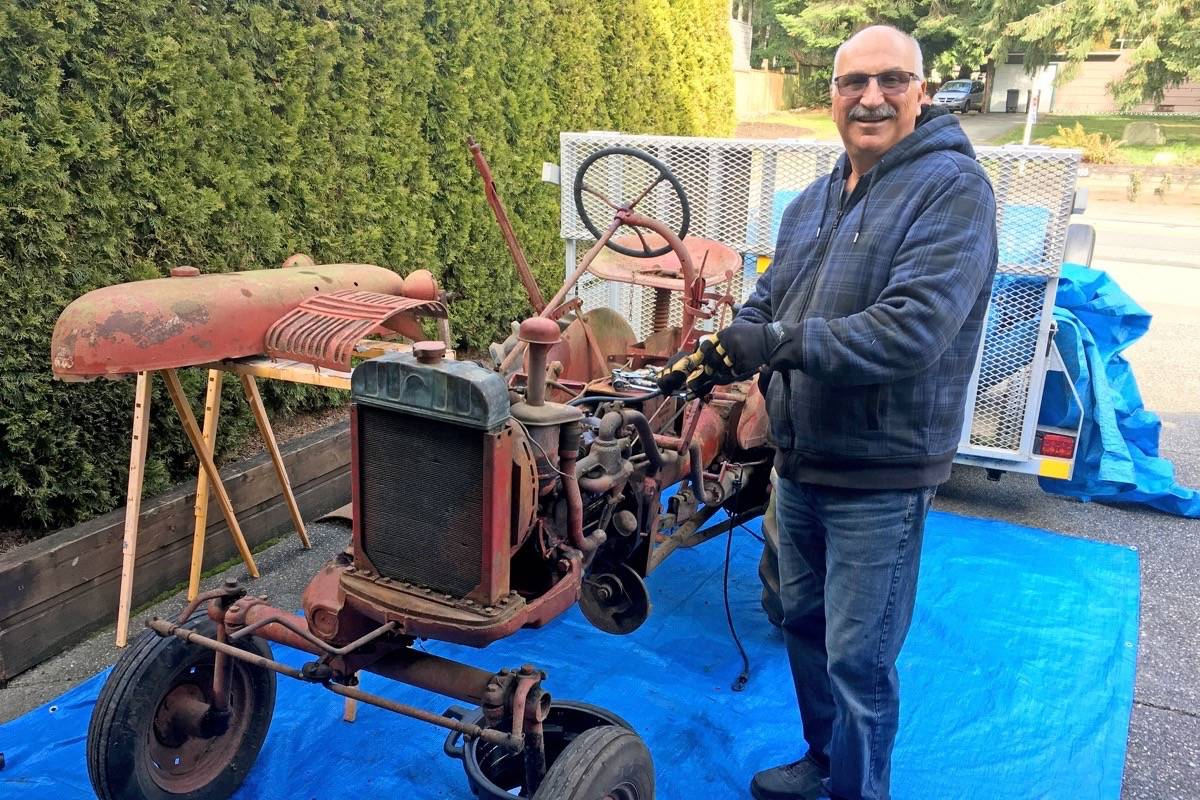 Ron Henze at work on the 1956 Farmall Cub he restored for his best friend's father. (Contributed photo)