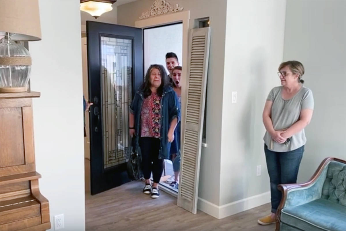 The moment Jacqueline Bay and her children got their first look inside their transformed home, the result of dozens of volunteers working hard for two weeks. (LifeApp video)