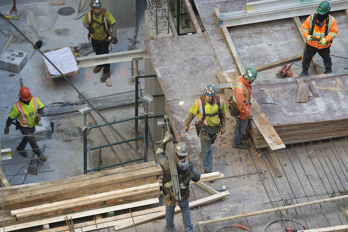 Construction workers help build a project in downtown Vancouver, Monday, April 6, 2020. A new report has found a third of Canada's Indigenous workers are in jobs facing a higher risk of being automated. THE CANADIAN PRESS/Jonathan Hayward