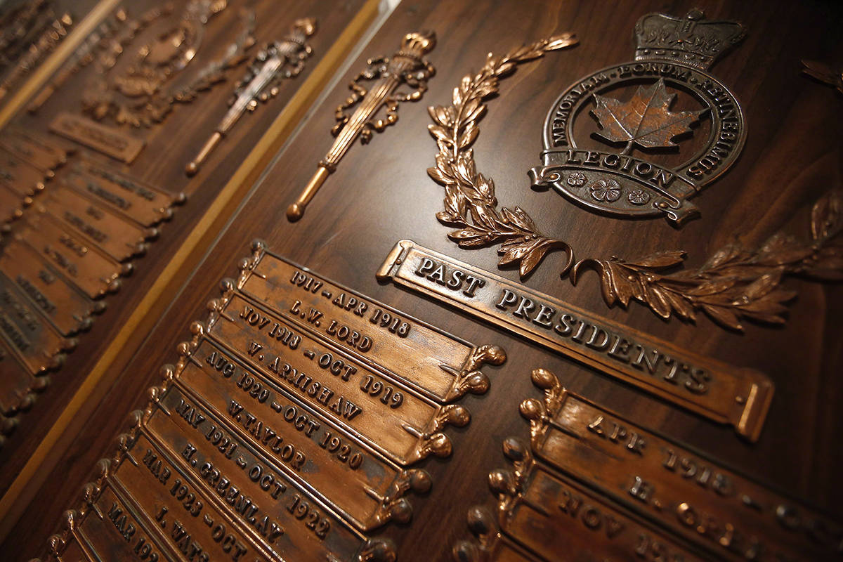 Plaques of past presidents hang on the walls at The Royal Canadian Legion, St James Branch No. 4 in Winnipeg, Thursday, November 8, 2018. A number of Royal Canadian Legion branches across the country have launched online fundraising efforts to keep their doors open after suffering financial setbacks because of COVID-19. THE CANADIAN PRESS/John Woods