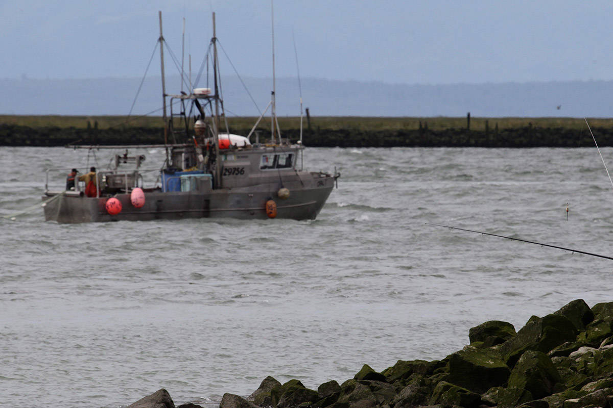 FILE – Sport fishermen cast their lines as a commercial fishing boat heads out on the Fraser River from Steveston Harbour during a 32-hour fishery window in Richmond, B.C., on Thursday August 26, 2010. THE CANADIAN PRESS/Darryl Dyck