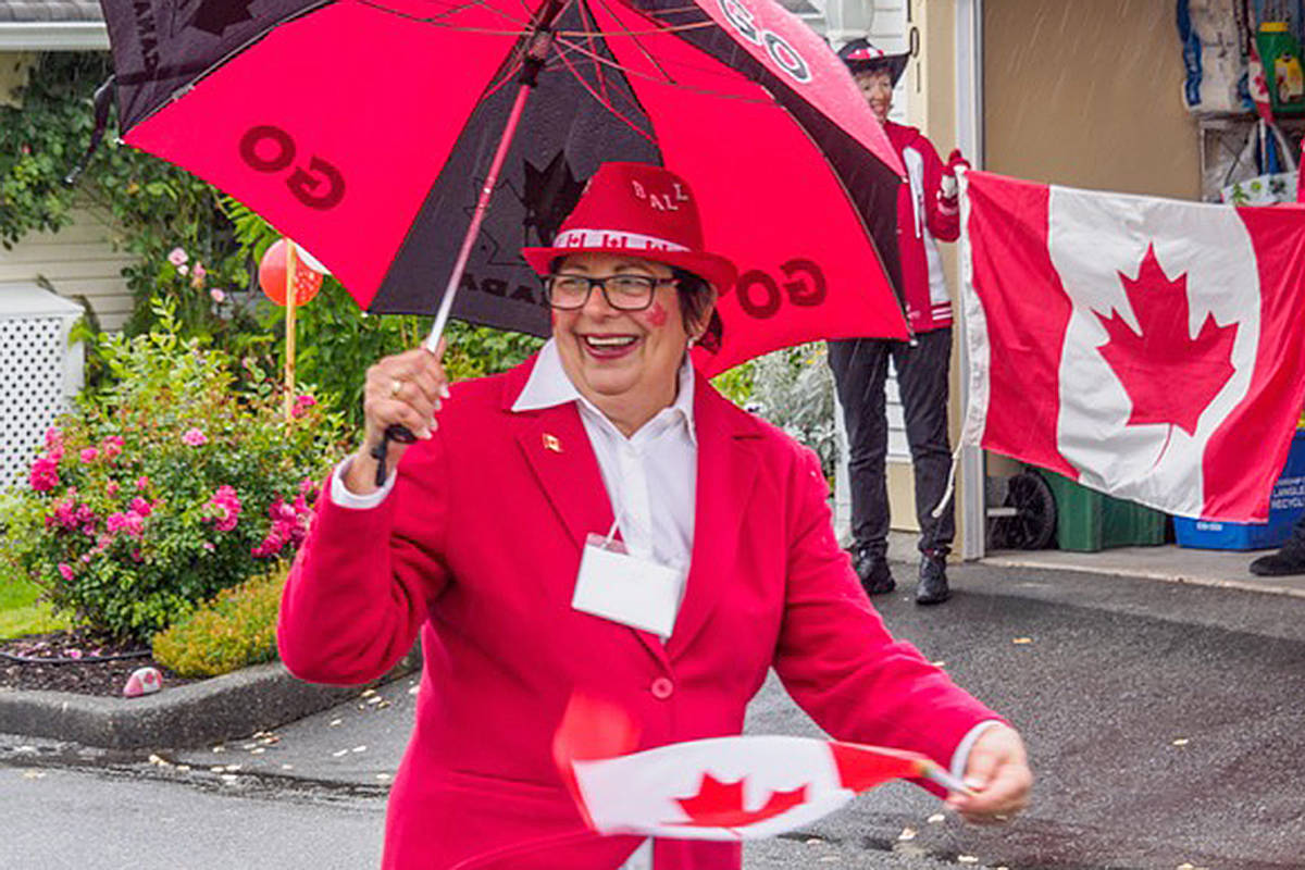 Diane Cougar, the tour bocci captain for the complex, was decked out in red for the parade. (Bev Genge/Special to the Langley Advance Times)