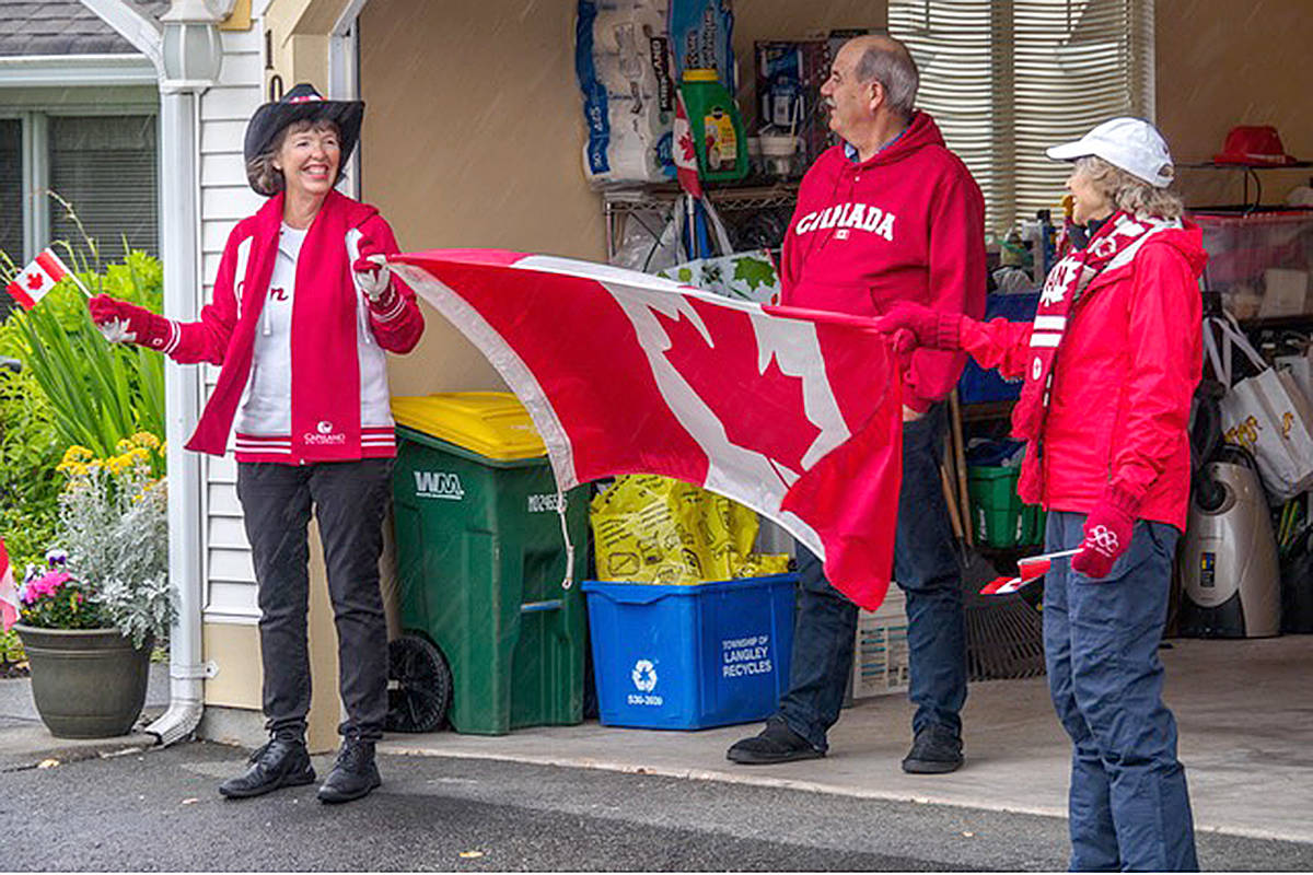 Karen Klaver, the centre's table tennis organizer, Nico Klaver, and Susan Mouat watched on as the parade marched past. (Bev Genge/Special to the Langley Advance Times)