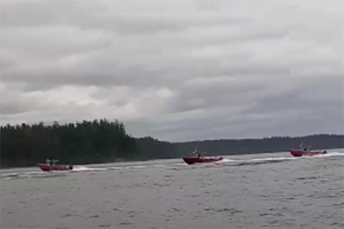 """A screenshot of a video posted to social media on Saturday, July 4, 2020 shows Queen Charlotte Lodge fishing vessels boating by local residents. The incident at sea has been described as """"dangerous"""" by both Duffy Edgars, chief councillor for the Old Massett Village Council, and lodge president Paul Clough. (Brandon Kallio image)"""