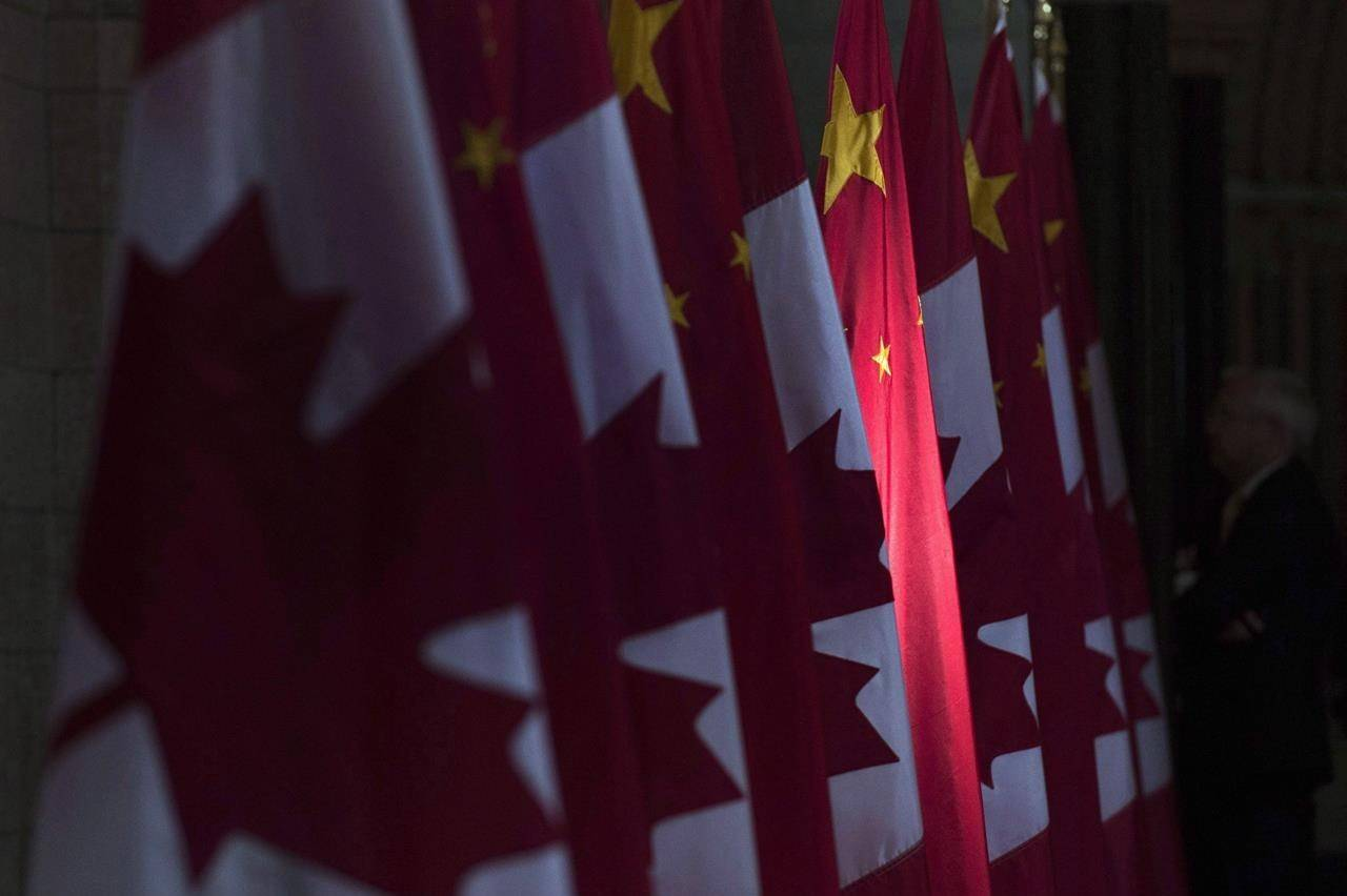 A Chinese flag is illuminated by sunshine in the Hall of Honour on Parliament Hill in Ottawa, Thursday, September 22, 2016. China is threatening retaliation against Canada after Prime Minister Justin Trudeau condemned a new security law giving Beijing more control over Hong Kong.. THE CANADIAN PRESS/Adrian Wyld