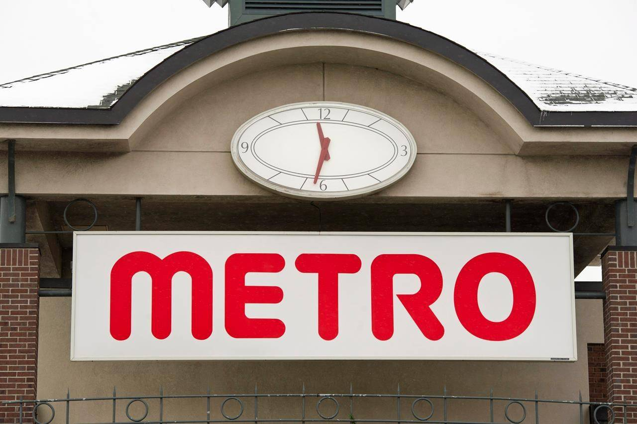 The logo of a Metro grocery store is seen Tuesday, January 31, 2012 in Montreal. Union leaders who represents thousands of grocery store workers are telling MPs there is no reason why large chains are cutting pandemic-related pay premiums since the pandemic hasn't gone away.THE CANADIAN PRESS/Paul Chiasson