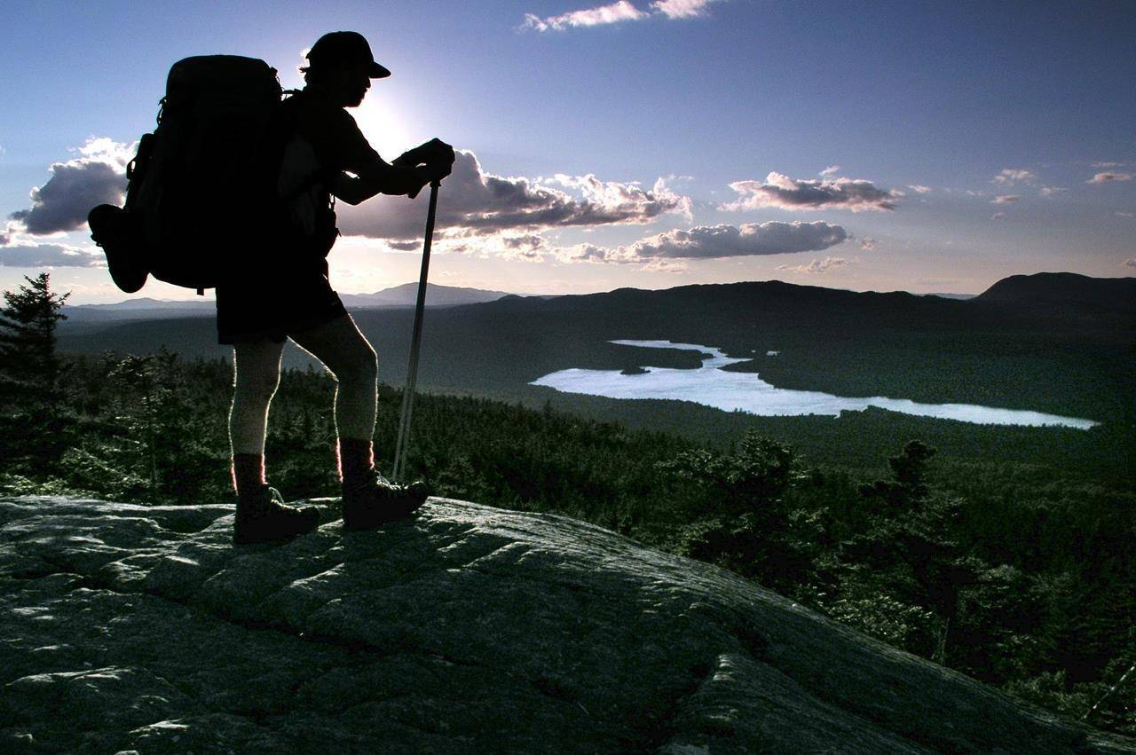A hiker pauses on Chairback Mountain overlooking Long Pond on the 100-Mile Wilderness section of the Appalachian Trail north of Monson, Maine, in this September 2004 file photo. COVID-19 restrictions on camping site reservation and other forms of travel have led to increased demand and system bottlenecking, so when reservations opened across British Columbia on June 1, they went quickly. THE CANADIAN PRESS/AP/Robert F. Bukaty