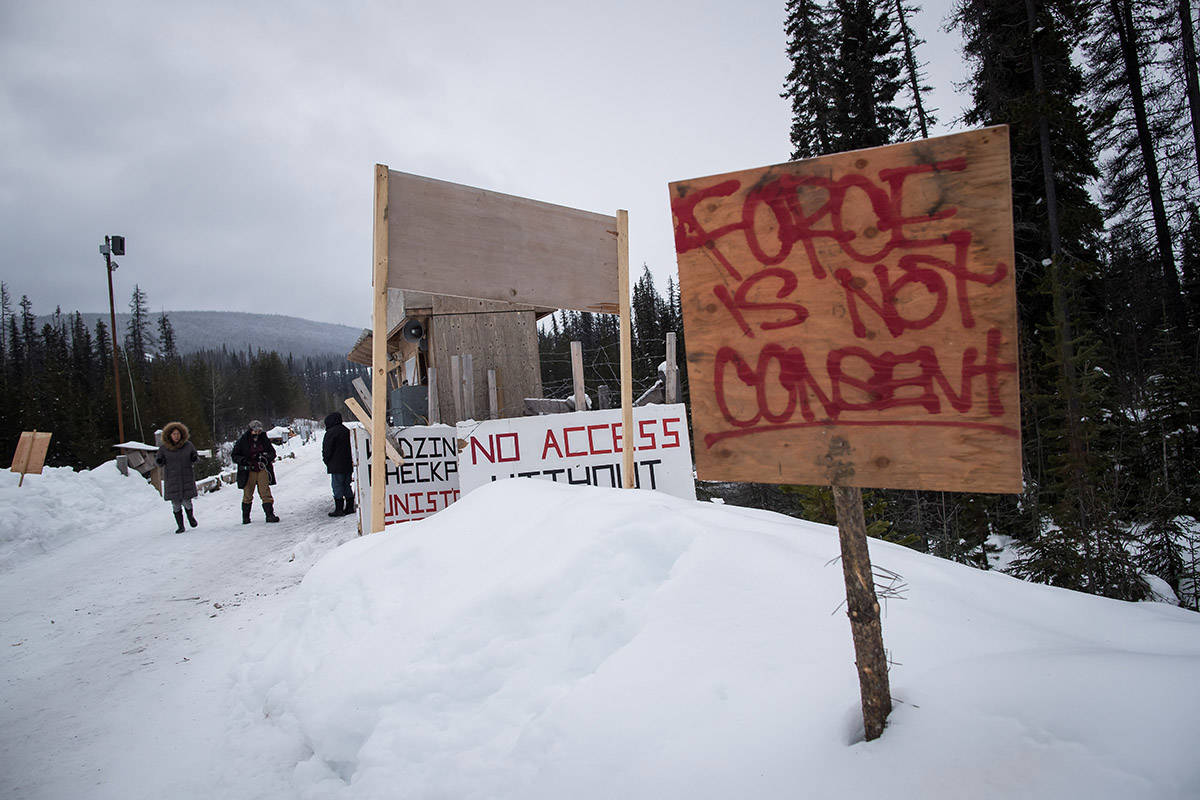 A checkpoint is seen at a bridge leading to the Unist'ot'en camp on a remote logging road near Houston, B.C., on January 17, 2019. A natural gas pipeline project has polarized many communities across northern British Columbia in a dispute a Wet'suwet'en elder says he hopes will be resolved through dialogue. Coastal GasLink is building the 670-kilometre pipeline from British Columbia's northeast to Kitimat on the coast. The company has signed agreements with all 20 elected First Nation councils along its path, but the hereditary clan chiefs who are leaders under the traditional form of governance say the project has no authority without their consent.THE CANADIAN PRESS/Darryl Dyck