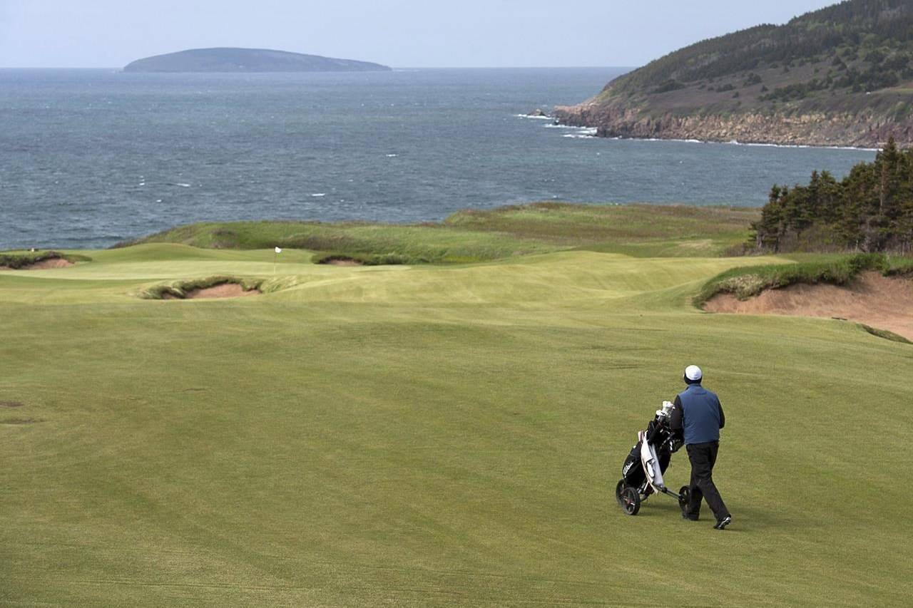 The 562 yard, par 5, 15th hole at Cabot Cliffs in Inverness, N.S. on June 1, 2016. If it seems like it's been harder to get a tee time this summer, it's not just your imagination.Golf Canada reports that there were 17 per cent more scores registered with the national sport body this June compared to the same month last year. THE CANADIAN PRESS/Andrew Vaughan