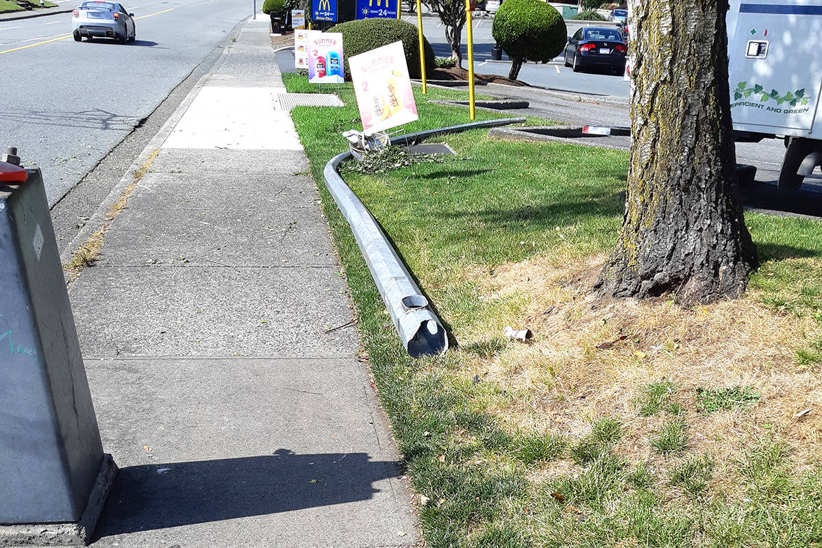 The driver of a stolen bucket truck ran into a traffic pole and lamp standard in the area of Bourquin Crescent and South Fraser Way on Monday (July 6). (Abbotsford Police Department photo)