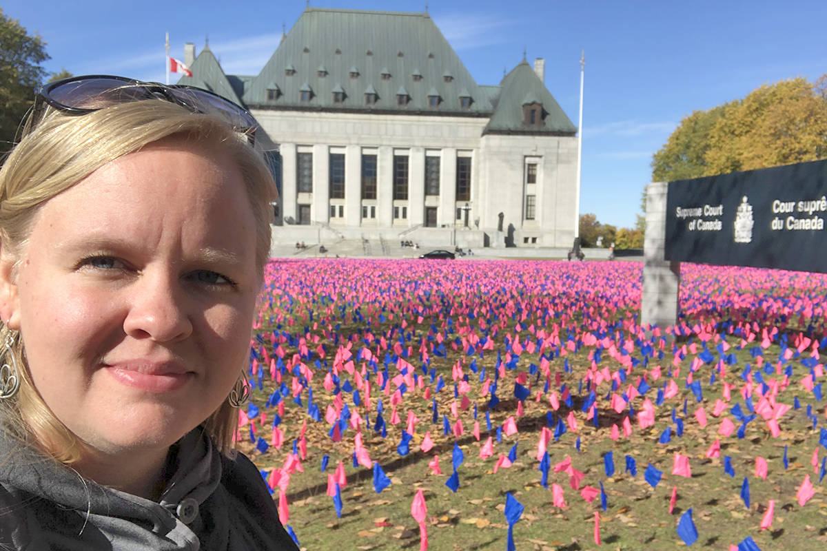 Elyse Vroom visited a pink flag display outside the Supreme Court of Canada and is involved with setting up a display in Langley on July 11. (Elyse Vroom/Special to the Langley Advance Times)