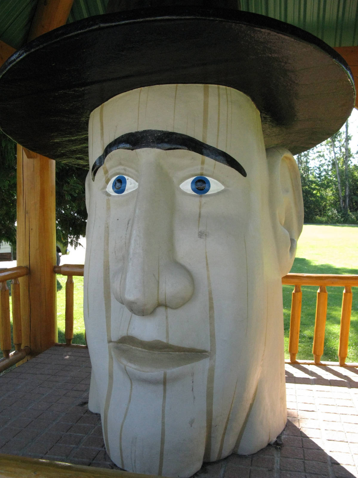 Woodenhead, carved from a large stump in the 1940s, watches motorists along the Trans Canada Highway in Revelstoke. Do you know the length of the Trans Canada Highway? (John Arendt - Black Press)