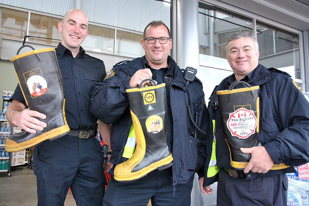 Probationary firefighter Nick Stobbe, firefighter Tim Payne, and lieutenant Andrew Penny all participated in the 2018 firefighter boot drive for Muscular Dystrophy Canada at the Save-On-Foods on 64th Avenue. COVID-19 has forced the firefighters charity to cancel a number of fundraisers, but the boot drive could still happen. (Langley Advance Times file)