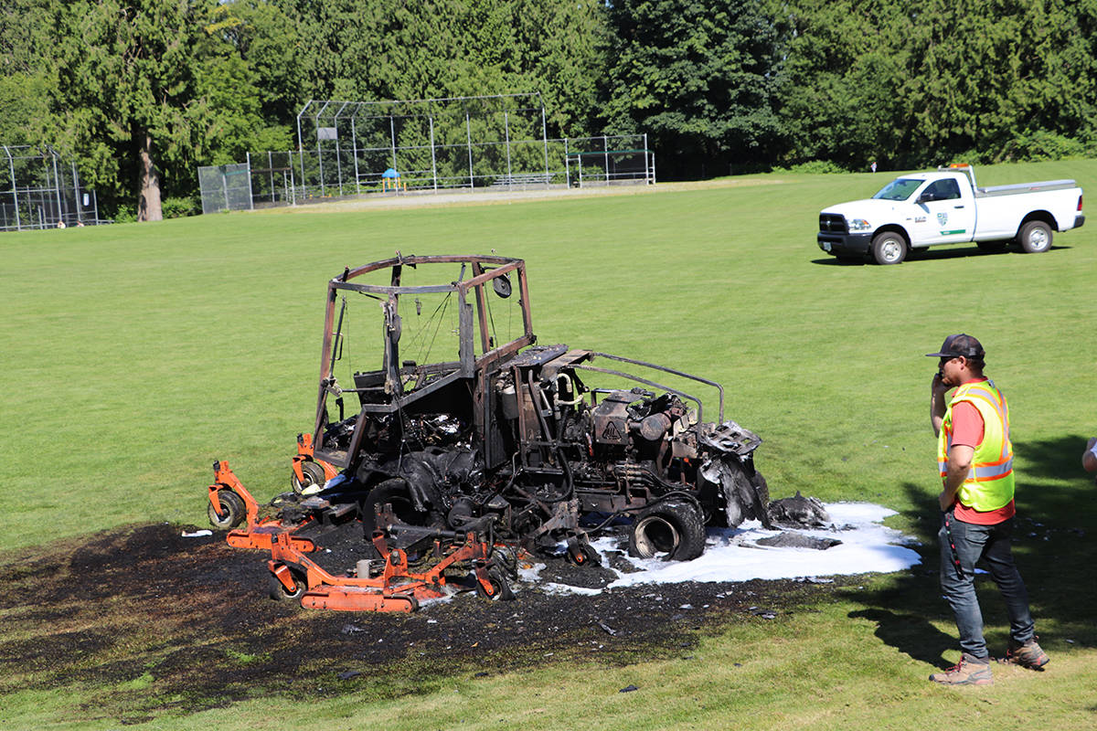 A lawnmower caught fire while the driver was mowing the field at Topham Elementary on Tuesday, July 14, 2020. Dan Allen, acting supervisor of parks and recreation for Township of Langley, was on scene to investigate the cause. No injuries were reported. (Joti Grewal/Langley Advance Times)