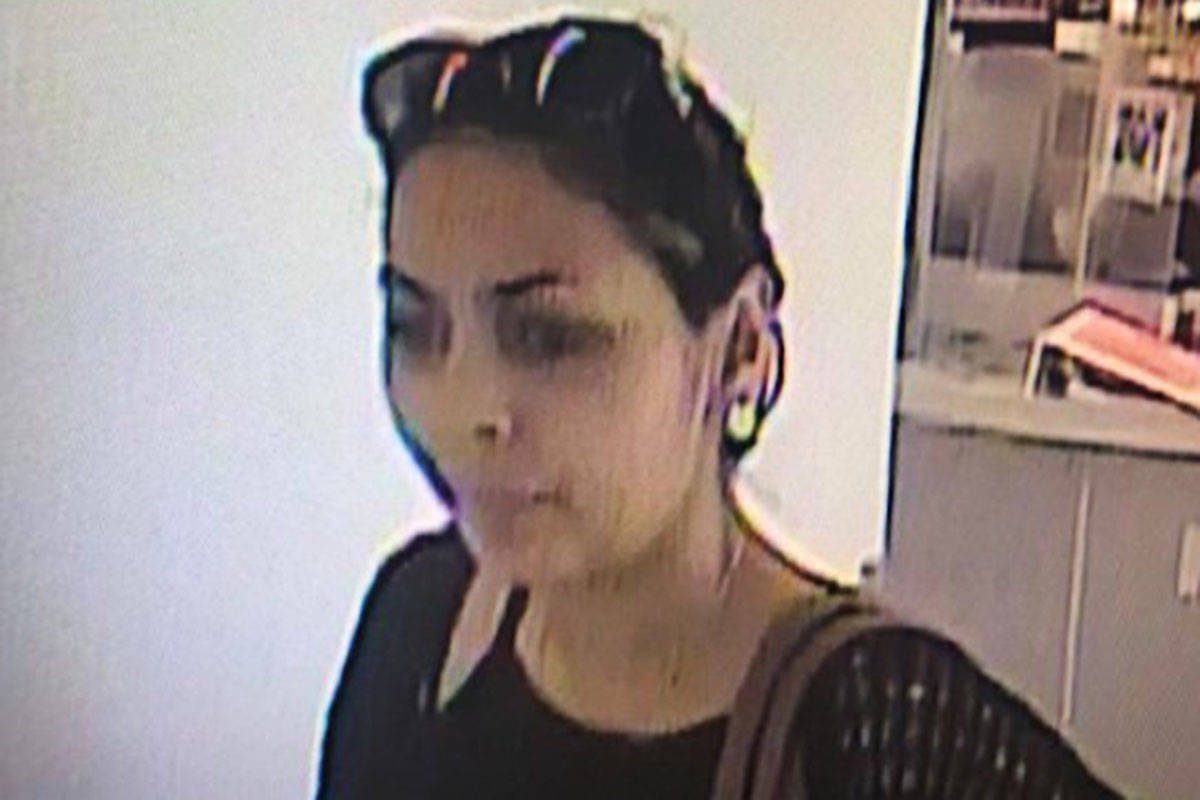 Langley RCMP say this woman is one of two suspects in the theft of about $700 worth of cosmetics. (Langley RCMP)