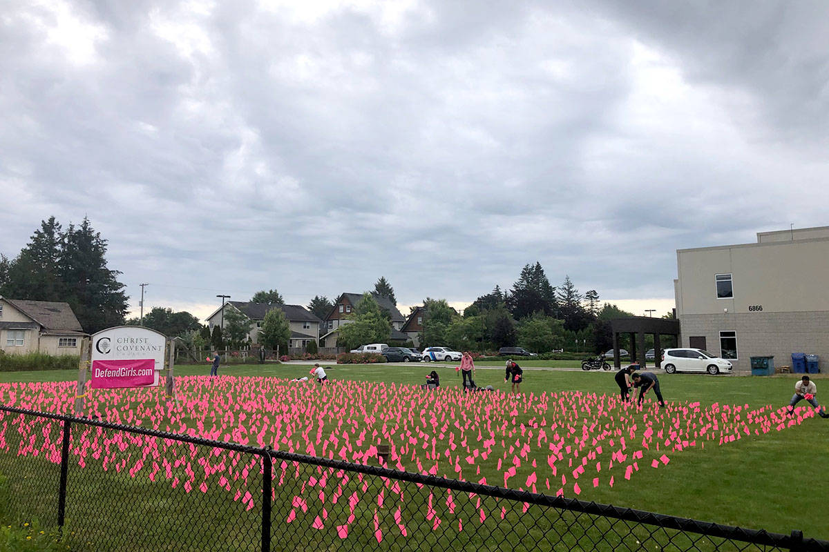 Pink flags on Langley church grounds raise awareness about sex-selective abortion