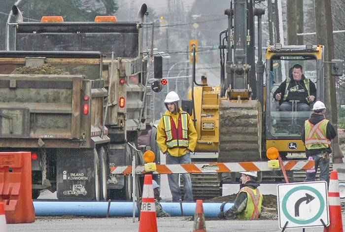 Crews replaced water, sanitary and storm water pipes in Langley City along 200 Street between Fraser Highway and 50 Avenue in 2015 (Langley Advance Times file)