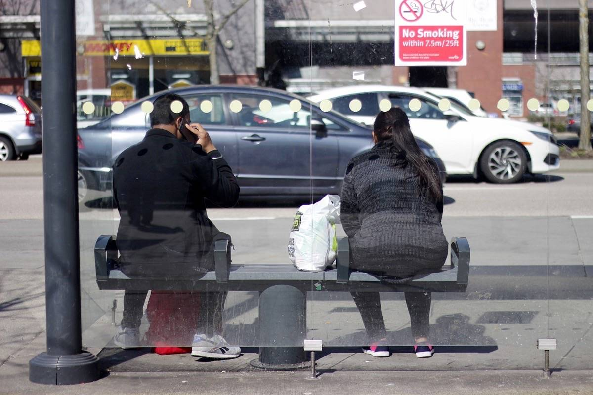 People wait for a bus at Newton Exchange on Friday, March 20, 2020. (Photo: Lauren Collins)