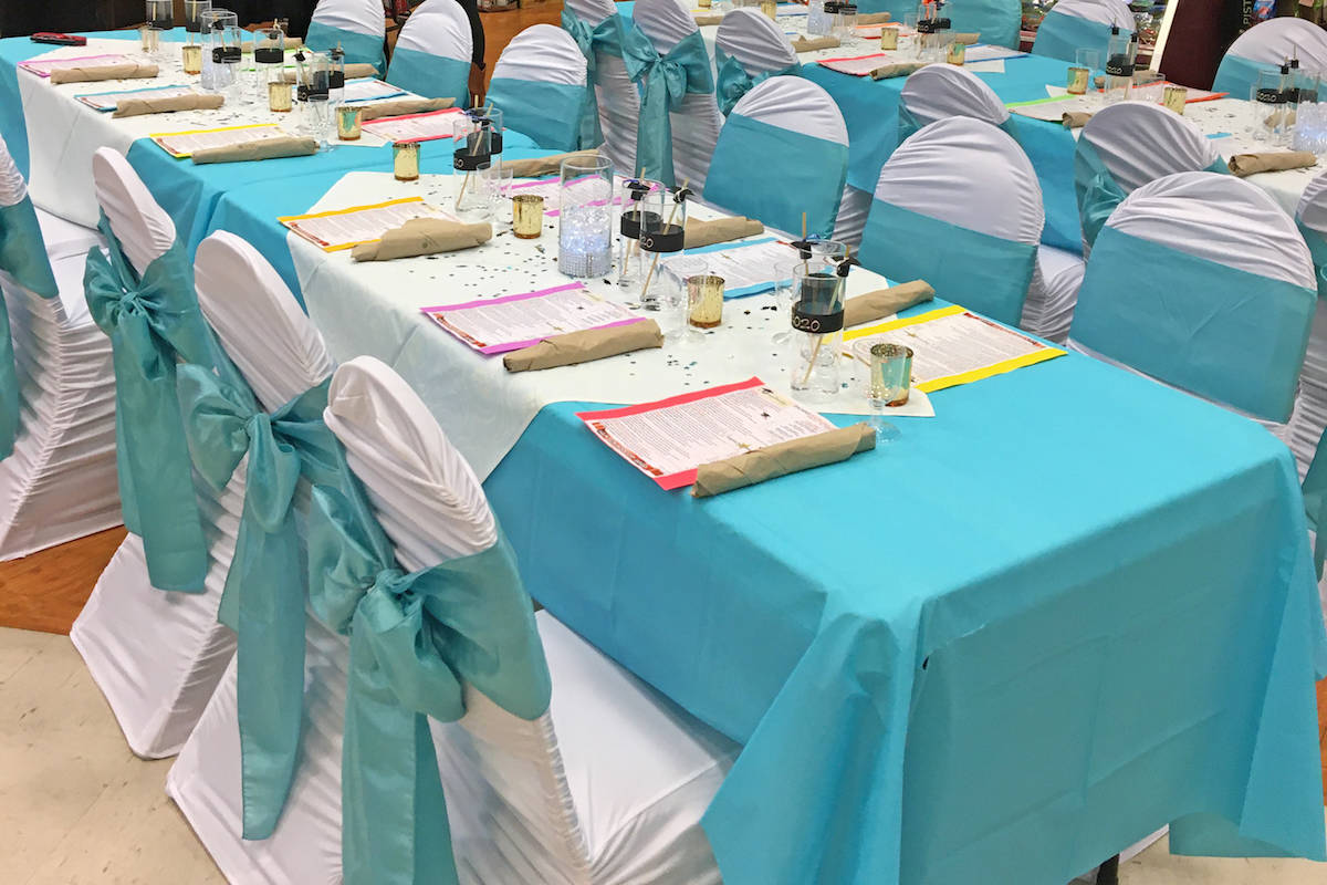 The IGA was closed early on July 7, the lights were dimmed and an area was set up with table and chair coverings accented in blue ribbons and fanciful place settings for prom. (Patricia Webb/Special to the Advance Times)