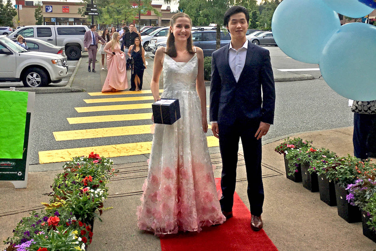 'More than any of us expected': Langley store owner throws surprise prom for grads on staff