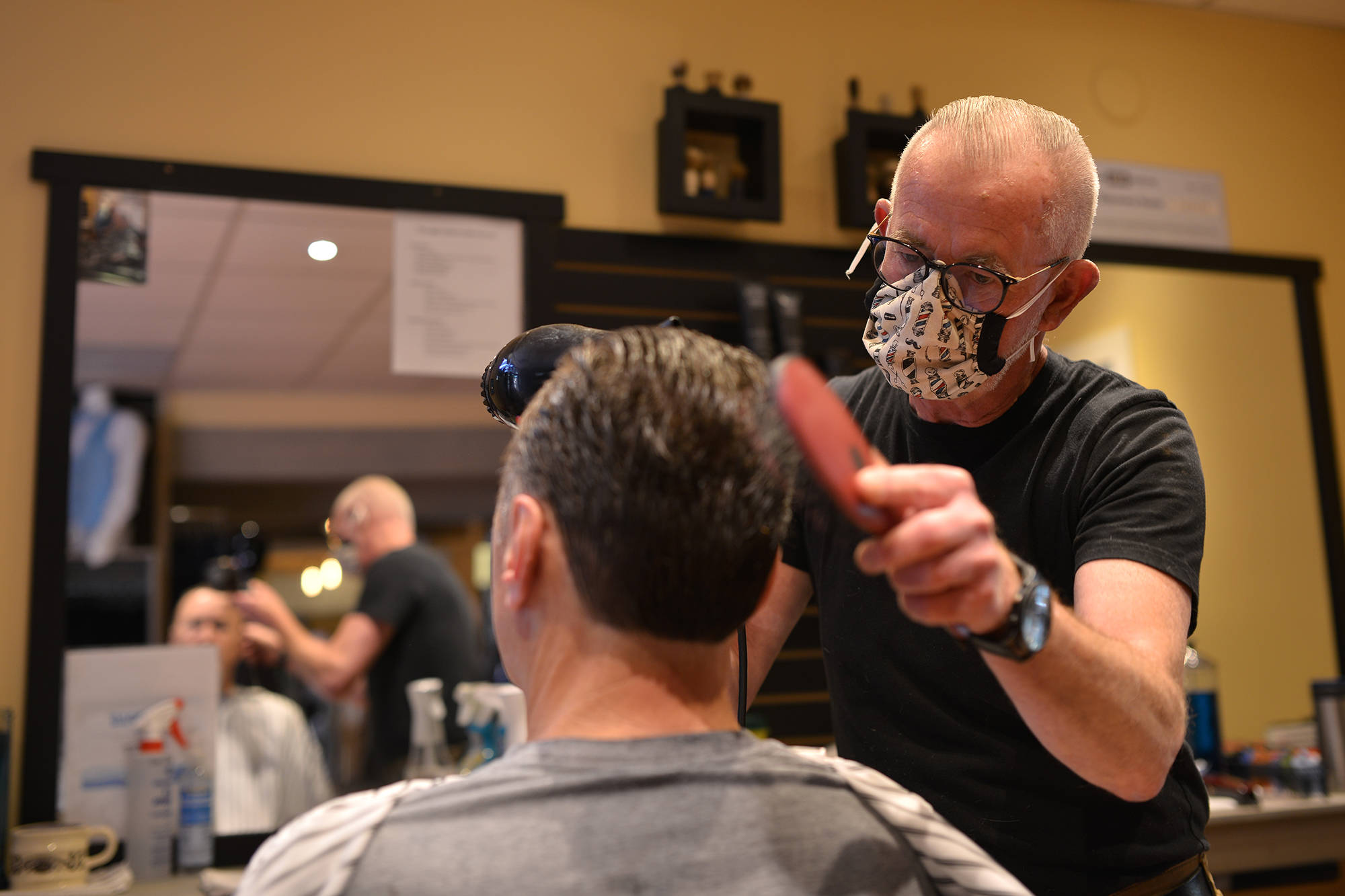 Barbers around the province are being urged to join a new BC Barbers Coalition, part of a new BC Barbers Association, a group created with the purpose of giving those in the industry a voice. Pictured above, a man receives a haircut shortly after shops reopened in Penticton. (Phil McLachlan - Western News - File)