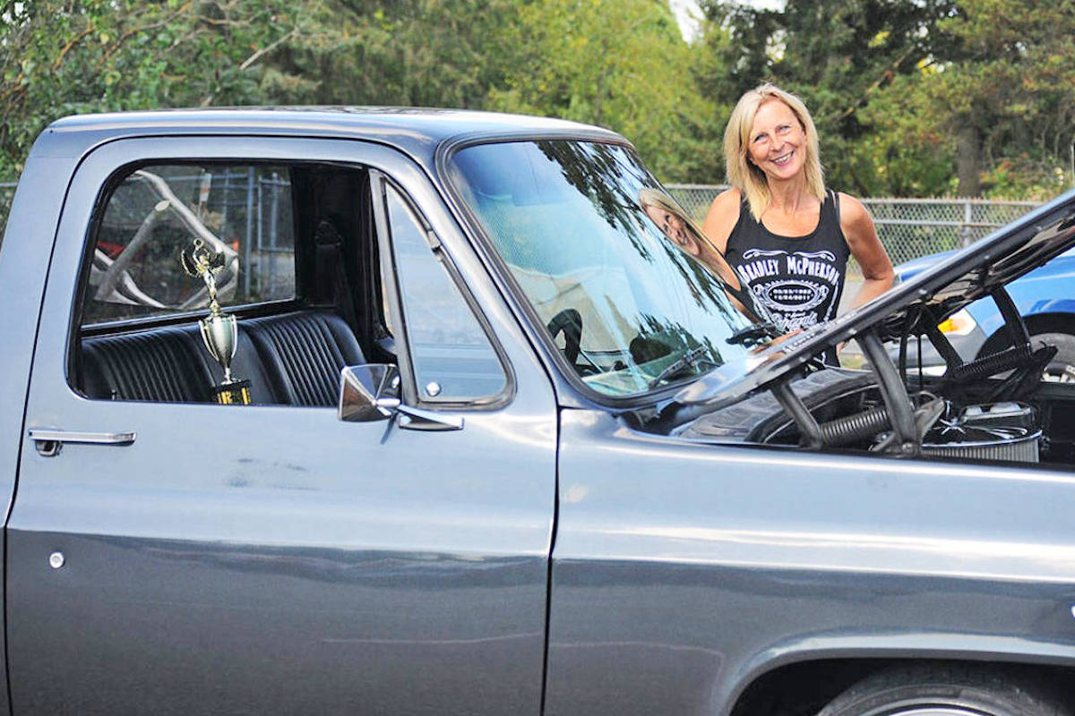 """Sue Simning, mother of the the late Bradley McPherson, stands with her son's black 1980 GMC Short Box, named """"Emma."""" (Special to the Aldergrove Star)"""